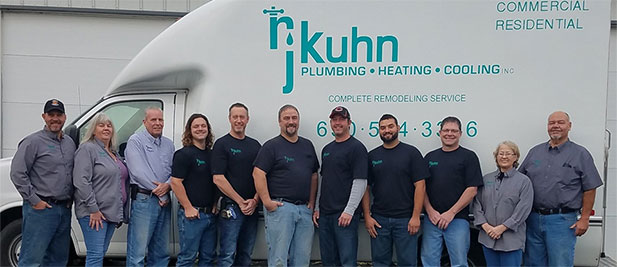 RJ Kuhn team posing in front of company truck